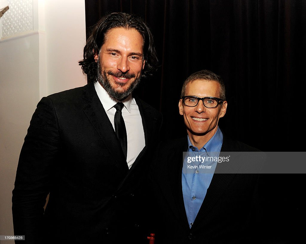 Actor <a gi-track='captionPersonalityLinkClicked' href=/galleries/search?phrase=Joe+Manganiello&family=editorial&specificpeople=2516889 ng-click='$event.stopPropagation()'>Joe Manganiello</a> (L) and HBO Programming President Michael Lombardo pose at the after party for the premiere of HBO's 'True Blood' at the Social Club on June 11, 2013 in Los Angeles, California.