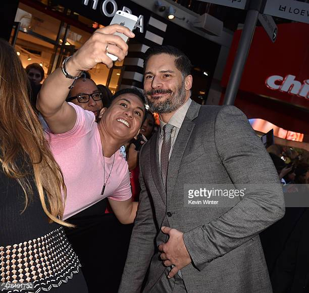Actor Joe Manganiello poses for a selfie with a fan as he attends the Universal Pictures' 'Jurassic World' premiere at the Dolby Theatre on June 9...
