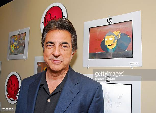 Actor Joe Mantegna poses with an animation cel of 'Simpsons' character 'Big Tony' at the 'Get Inked With Homer' benefit at the Wonderful World Art...