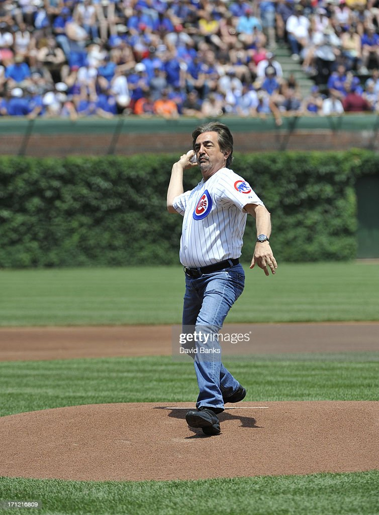 Actor Joe Mantegna throws out the first pitch before the game between the Chicago Cubs and the Houston Astros on June 23, 2013 at Wrigley Field in Chicago, Illinois.