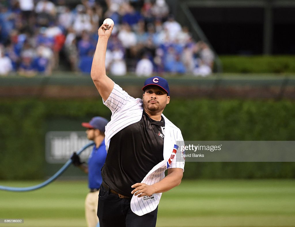 Actor Joe Minoso throws out a ceremonial first pitch before the game between the Chicago Cubs and the Los Angeles Dodgers on May 31, 2016 at Wrigley Field in Chicago, Illinois.