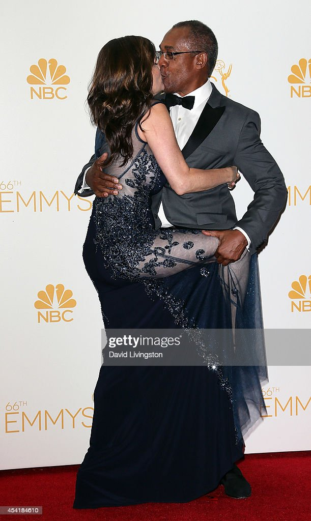 Actor <a gi-track='captionPersonalityLinkClicked' href=/galleries/search?phrase=Joe+Morton&family=editorial&specificpeople=243160 ng-click='$event.stopPropagation()'>Joe Morton</a> (R) and Christine Lietz pose in the press room at the 66th Annual Primetime Emmy Awards at the Nokia Theatre L.A. Live on August 25, 2014 in Los Angeles, California.