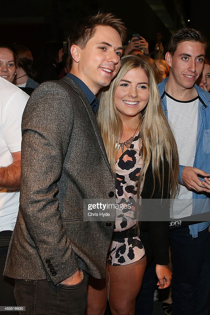 Actor Joe Thomas poses with a fan at the Queensland Premier of The Inbetweeners 2 at Event Cinemas, Robina on August 12, 2014 in Gold Coast, Australia. The Inbetweeners 2 will be released on 21 August 2014.