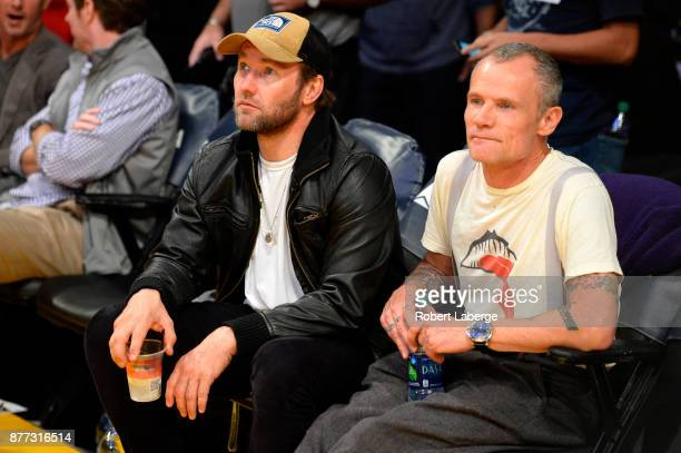 Actor Joel Edgerton and Michael Peter Balzary better known as 'Flea' during the game between the Los Angeles Lakers and the Denver Nuggets on...