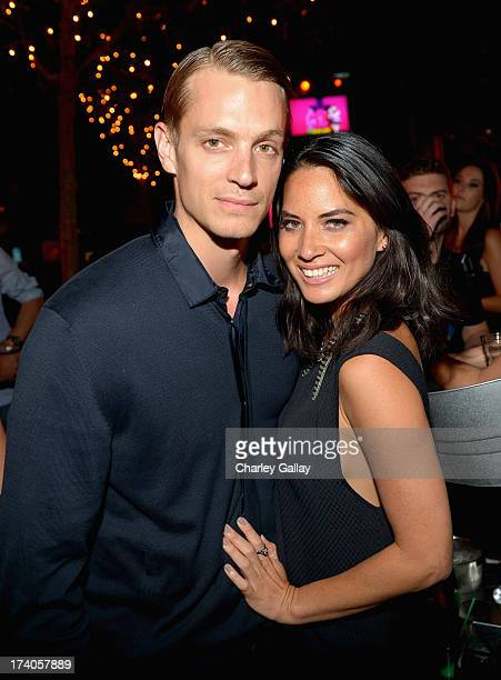 Actor Joel Kinnaman and actress Olivia Munn attend the Playboy and Universal Pictures' 'KickAss 2' event at ComicCon sponsored by AXE Black Chill on...