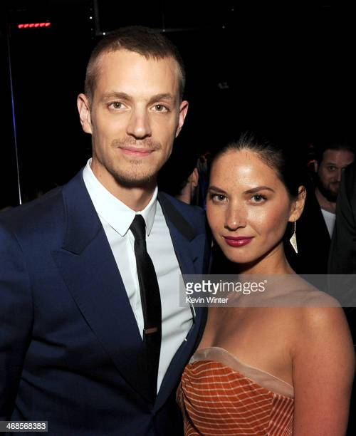 Actor Joel Kinnaman and actress Olivia Munn pose at the after party for the premiere of Columbia Pictures' 'Robocop' at OHM Nightclub on February 10...