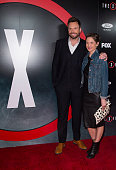 Actor Joel McHale and Sarah Williams attend the premiere of Fox's 'The XFiles' at California Science Center on January 12 2016 in Los Angeles...