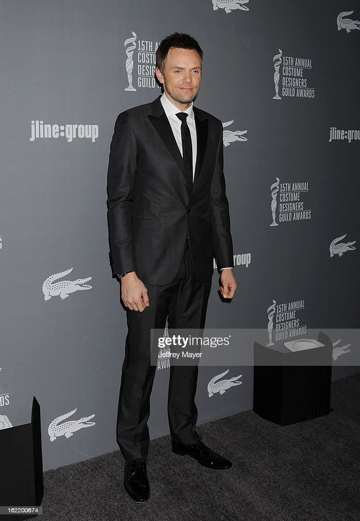 Actor Joel McHale arrives at the 15th Annual Costume Designers Guild Awards at The Beverly Hilton Hotel on February 19, 2013 in Beverly Hills, California.