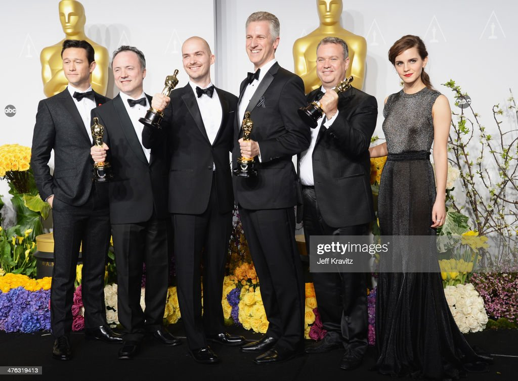 Actor Joesph GordonLevitt visual effects artists Tim Webber Chris Lawrence David Shirk Neil Corbould and actress Emma Watson pose in the press room...