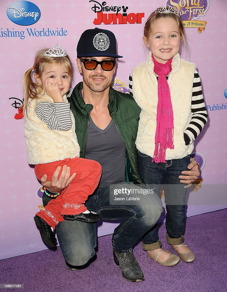 Actor Joey Lawrence and daughters Liberty Grace Lawrence (L) and Charleston Lawrence (R) attend the premiere of 'Sofia The First: Once Upon a Princess' at Walt Disney Studios on November 10, 2012 in Burbank, California.