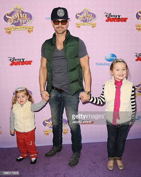 Actor Joey Lawrence and daughters Liberty Grace Lawrence and Charleston Lawrence attend the premiere of 'Sofia The First Once Upon a Princess' at...