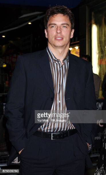Actor John Barrowman arrives for the UK charity premiere of DeLovely a musical portrait of American composer Cole Porter at the Empire Leicester...