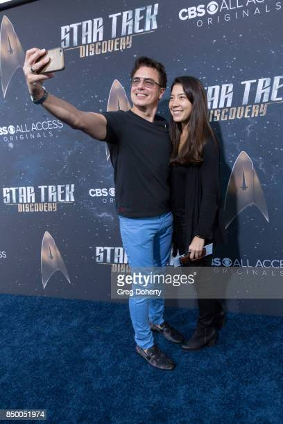 Actor John Barrowman takes a selfie as he arrives for the Premiere Of CBS's 'Star Trek Discovery' at The Cinerama Dome on September 19 2017 in Los...