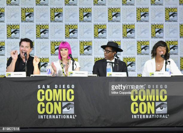 Actor John Barrowman writer Charlie Jane Anders actors Orlando Jones and Aisha Tyler speak onstage at SYFY hosts The Great Debate during ComicCon...