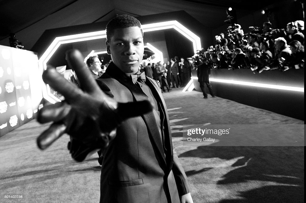 """Actor John Boyega attends the World Premiere of """"Star Wars: The Force Awakens"""" at the Dolby, El Capitan, and TCL Theatres on December 14, 2015 in Hollywood, California."""