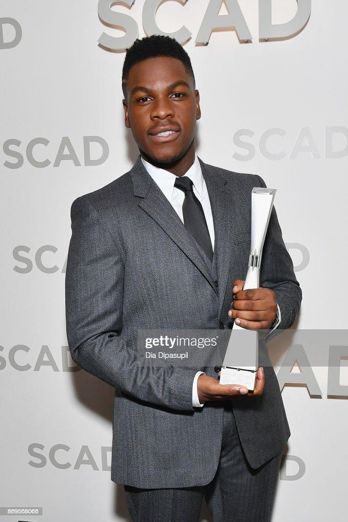 Actor John Boyega poses backstage with Vanguard Award at Trustees Theater during 20th Anniversary SCAD Savannah Film Festival on November 2, 2017 in Savannah, Georgia.
