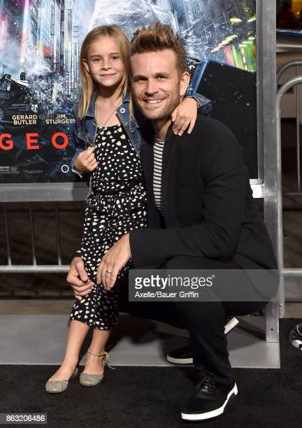 Actor John Brotherton and daughter arrive at the premiere of 'Geostorm' at TCL Chinese Theatre on October 16 2017 in Hollywood California