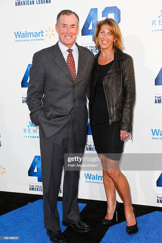 Actor John C. McGinley (L) and his wife, Nicole McGinley, attend the premiere of Warner Bros. Pictures' And Legendary Pictures' '42' at TCL Chinese Theatre on April 9, 2013 in Hollywood, California.