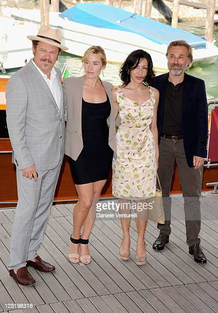 Actor John C Reilly actress Kate Winslet writer Yasmina Reza and actor Christoph Waltz arrive ahead of the 'Carnage' Photocall during the 68th Venice...