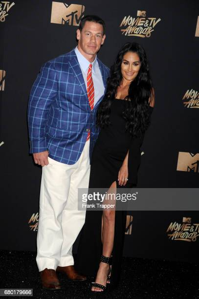Actor John Cena and Nikki Bella pose in the press room during the 2017 MTV Movie And TV Awards at The Shrine Auditorium