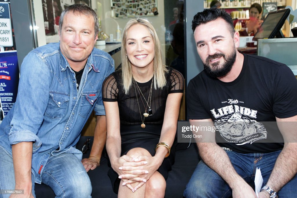 Actor <a gi-track='captionPersonalityLinkClicked' href=/galleries/search?phrase=John+Corbett&family=editorial&specificpeople=221714 ng-click='$event.stopPropagation()'>John Corbett</a>, actress <a gi-track='captionPersonalityLinkClicked' href=/galleries/search?phrase=Sharon+Stone&family=editorial&specificpeople=156409 ng-click='$event.stopPropagation()'>Sharon Stone</a> and President of Kiehl's <a gi-track='captionPersonalityLinkClicked' href=/galleries/search?phrase=Chris+Salgardo&family=editorial&specificpeople=5384803 ng-click='$event.stopPropagation()'>Chris Salgardo</a> rides at the Kiehl's Since 1851 Liferide for amfAR at The Grove on August 8, 2013 in Los Angeles, California.