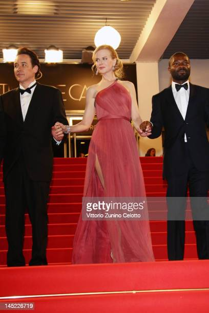 Actor John Cusack actress Nicole Kidman and actor David Oyelowo depart the 'The Paperboy' premiere during the 65th Annual Cannes Film Festival at...