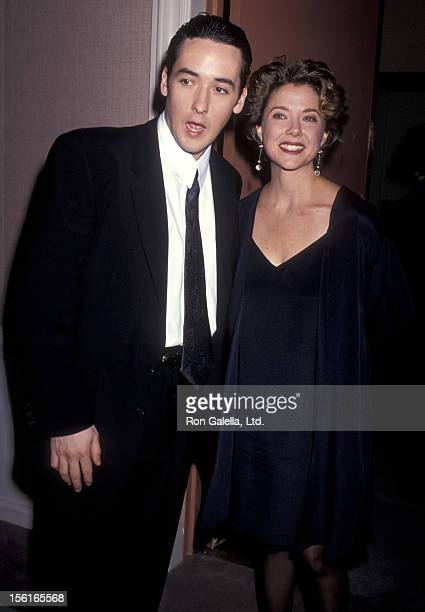 Actor John Cusack and actress Annette Bening attend the 49th Annual Golden Globe Awards on January 19 1991 at Beverly Hilton Hotel in Beverly Hills...