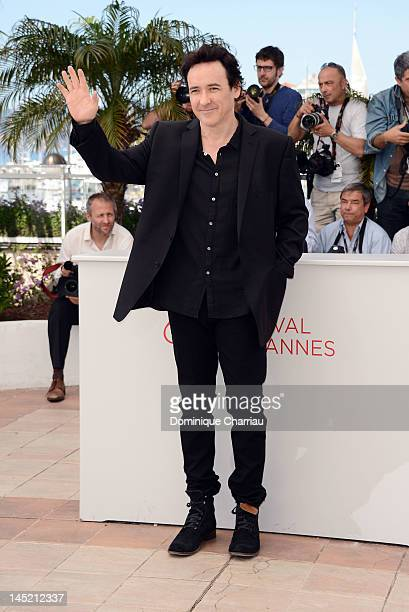 Actor John Cusack poses at the 'The Paperboy' photocall during the 65th Annual Cannes Film Festival at Palais des Festivals on May 24 2012 in Cannes...