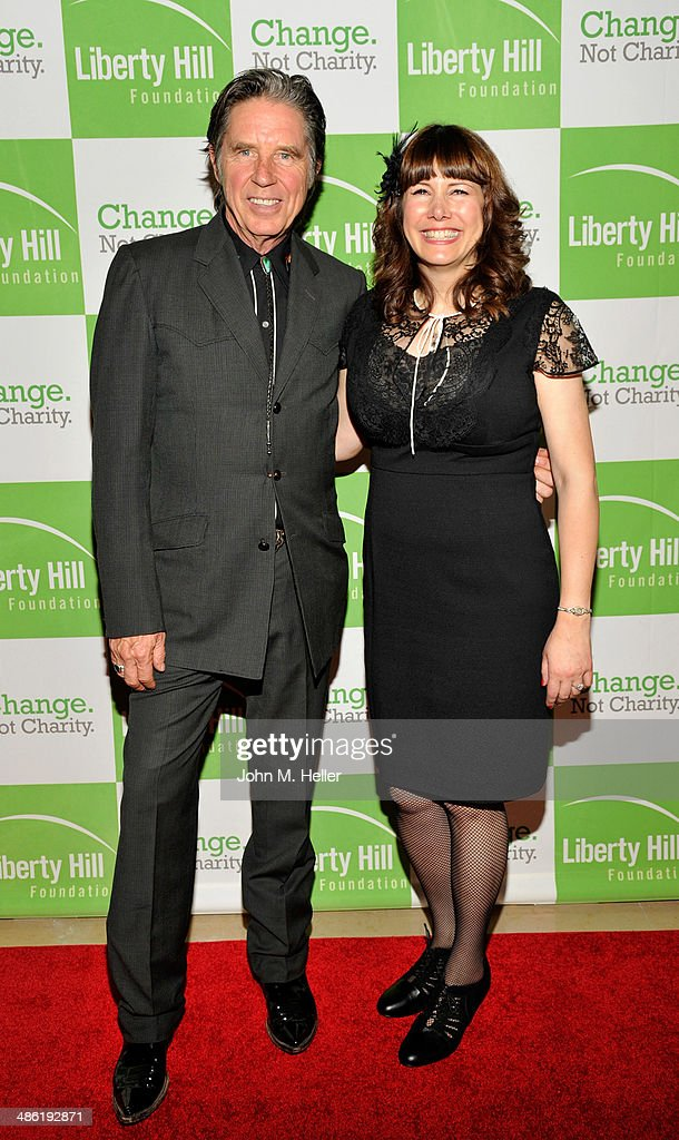 Actor John Doe and musician Cindy Wasserman attend the Liberty Hill's Upton Sinclair Awards dinner at The Beverly Hilton Hotel on April 22, 2014 in Beverly Hills, California.