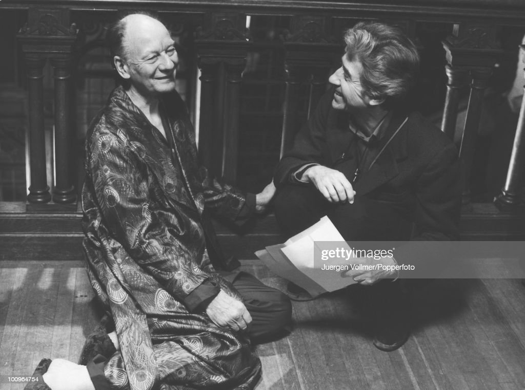 Actor John Gielgud (1904 - 2000) with director Alain Resnais during the filming of 'Providence', 1976.