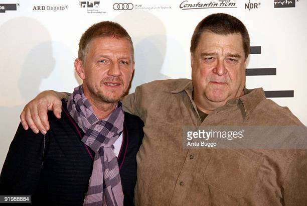 Actor John Goodman and director Soenke Wortmann attend the photocall of 'Pope Joan' at Hotel Ritz Carlton on October 19 2009 in Berlin Germany