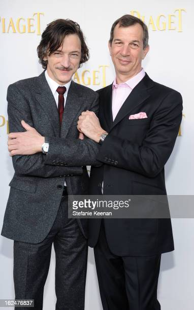 Actor John Hawkes and CEO of Piaget Philippe LeopoldMetzger pose in the Piaget Lounge during The 2013 Film Independent Spirit Awards on February 23...