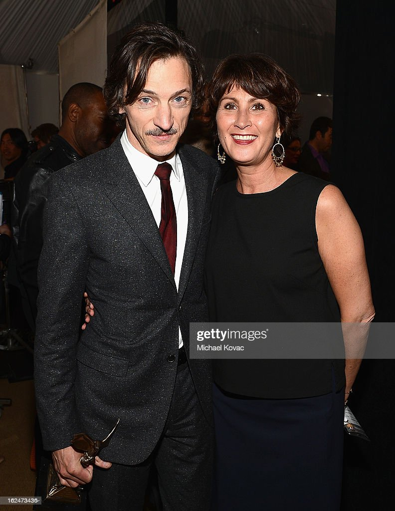 Actor John Hawkes and PR Manager of Piaget Natacha Hertz pose in the Piaget Lounge during The 2013 Film Independent Spirit Awards on February 23, 2013 in Santa Monica, California.