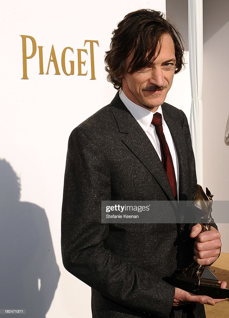 Actor John Hawkes poses in the Piaget Lounge during The 2013 Film Independent Spirit Awards on February 23, 2013 in Santa Monica, California.
