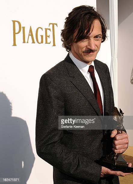 Actor John Hawkes poses in the Piaget Lounge during The 2013 Film Independent Spirit Awards on February 23 2013 in Santa Monica California