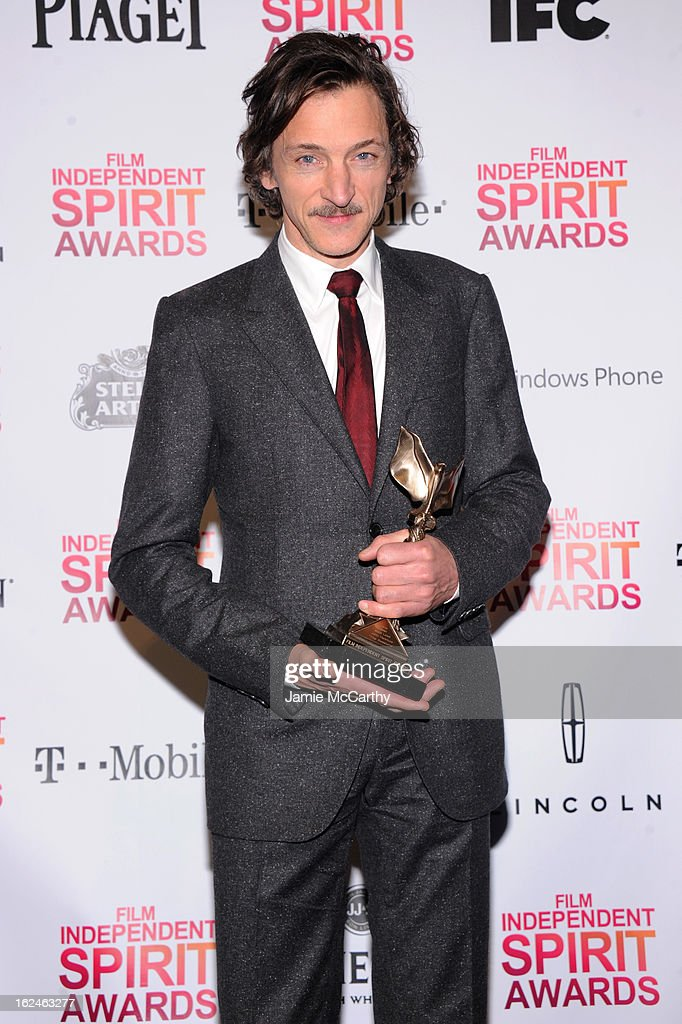 Actor <a gi-track='captionPersonalityLinkClicked' href=/galleries/search?phrase=John+Hawkes+-+Actor&family=editorial&specificpeople=224944 ng-click='$event.stopPropagation()'>John Hawkes</a> poses with the Best Actor award for The Sessions during the 2013 Film Independent Spirit Awards at Santa Monica Beach on February 23, 2013 in Santa Monica, California.