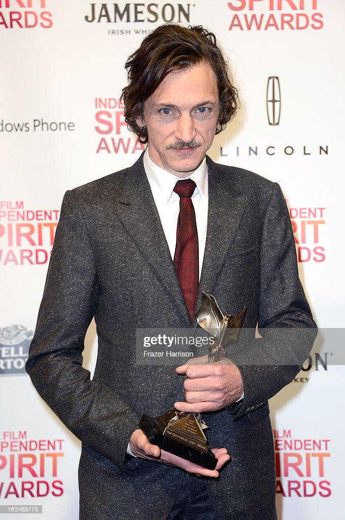 Actor <a gi-track='captionPersonalityLinkClicked' href=/galleries/search?phrase=John+Hawkes+-+Actor&family=editorial&specificpeople=224944 ng-click='$event.stopPropagation()'>John Hawkes</a> poses with the Best Male Lead award for 'The Sessions' in the press room during the 2013 Film Independent Spirit Awards at Santa Monica Beach on February 23, 2013 in Santa Monica, California.