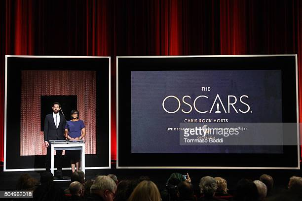 Actor John Krasinski and President of the Academy Cheryl Boone Isaacs speak on stage during the 88th Oscars Nominations Announcement at Academy Of...
