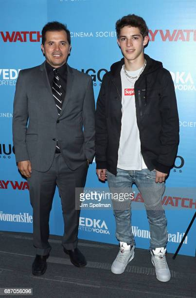 Actor John Leguizamo and son attend the screening of 'Baywatch' hosted by The Cinema Society at Landmark Sunshine Cinema on May 22 2017 in New York...