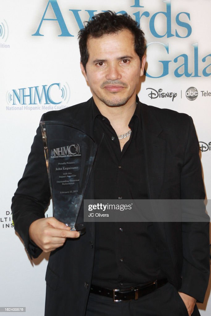 Actor <a gi-track='captionPersonalityLinkClicked' href=/galleries/search?phrase=John+Leguizamo&family=editorial&specificpeople=167163 ng-click='$event.stopPropagation()'>John Leguizamo</a> poses with his Outstanding Theatrical Performance Award during the National Hispanic Media Coalition's 16th Annual Impact Awards Gala at the Beverly Wilshire Four Seasons Hotel on February 22, 2013 in Beverly Hills, California.