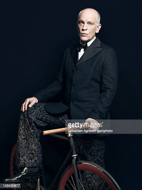 Actor John Malkovich poses for Madame Figaro on December 10 2011 in Paris France PUBLISHED IMAGE Figaro ID 102732003 Jacket and pants by...