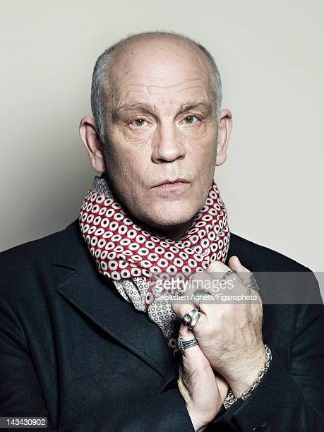 Actor John Malkovich poses for Madame Figaro on December 10 2011 in Paris France Figaro ID 102732010 Jacket and scarf by Technobohemian by John...