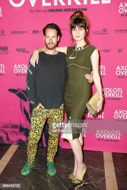 US actor John Robinson and Spain actress Araceli Jover attend the 'Axolotl Overkill' Berlin Premiere at Volksbuehne RosaLuxemburgPlatz on June 21...