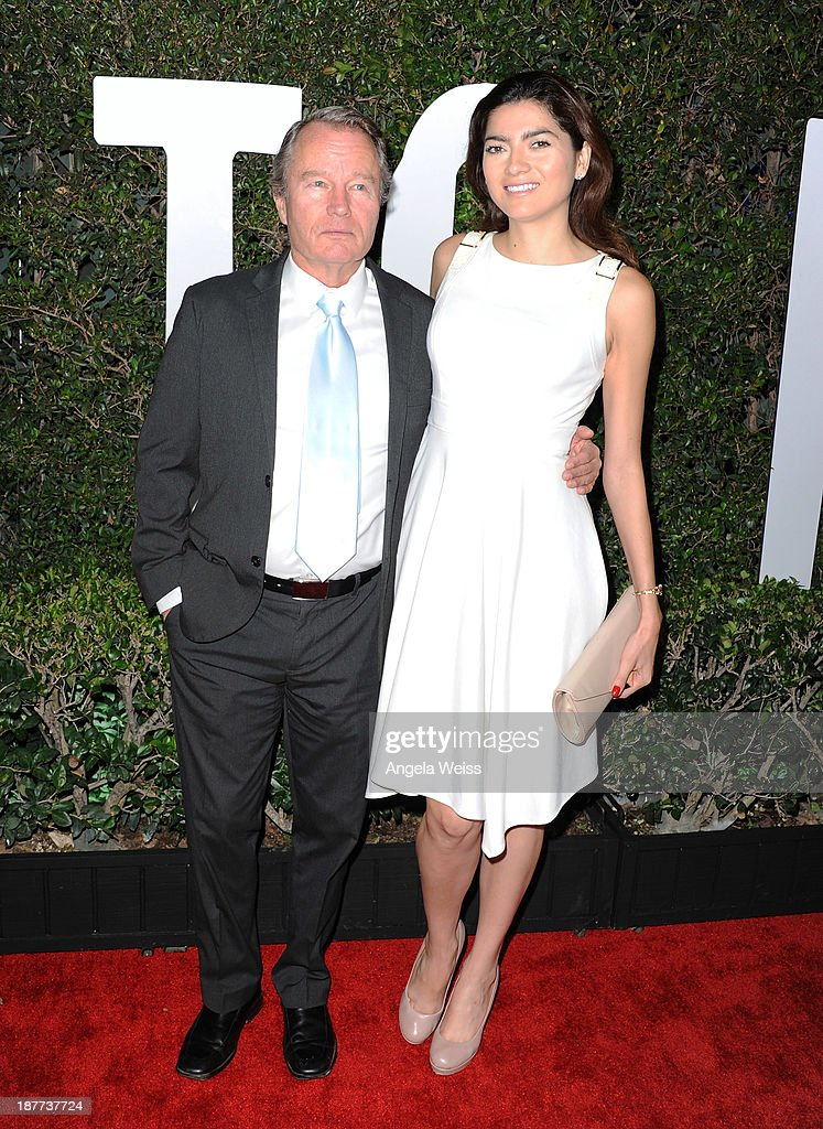 Actor John Savage and Blanca Blanco attend the premiere of The Weinstein Company's 'Mandela: Long Walk To Freedom' at ArcLight Cinemas Cinerama Dome on November 11, 2013 in Hollywood, California.