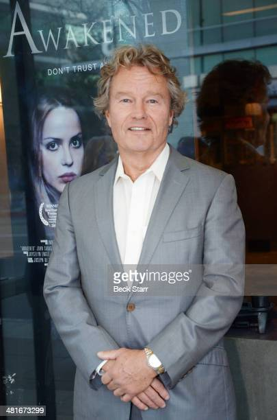 Actor John Savage attends 'Awakened' Los Angeles premiere at Laemmle's Music Hall 3 on March 30 2014 in Beverly Hills California