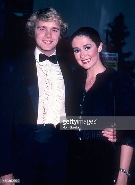Actor John Schneider and girlfriend actress Tawny Little attend the American Video Association's First Annual American Video Awards on April 6 1983...