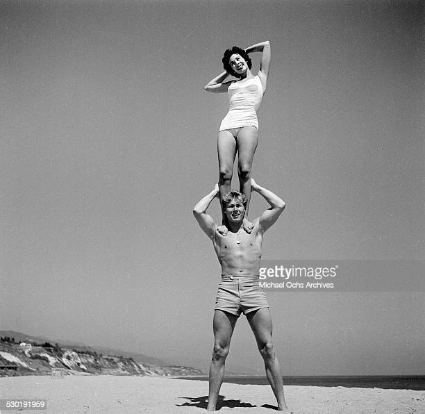 Actor John Smith and actress Sharon Dexter pose on the beach in Los AngelesCA