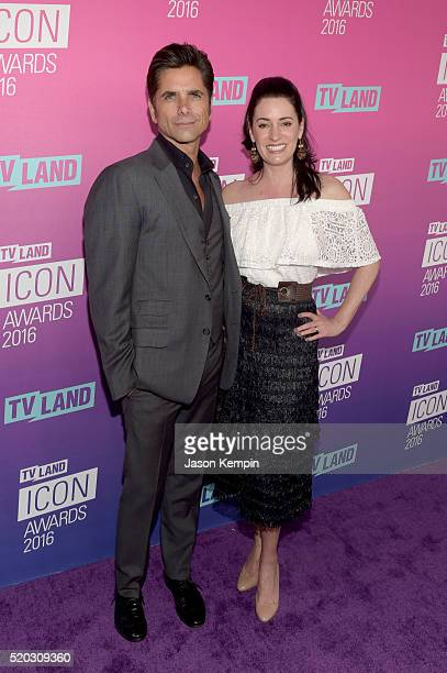 Actor John Stamos and actress Paget Brewster attend 2016 TV Land Icon Awards at The Barker Hanger on April 10 2016 in Santa Monica California
