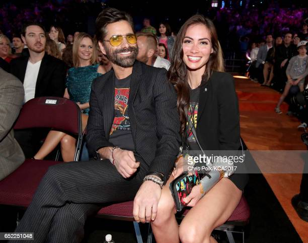 Actor John Stamos and Caitlin McHugh at Nickelodeon's 2017 Kids' Choice Awards at USC Galen Center on March 11 2017 in Los Angeles California