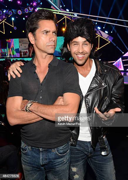 Actor John Stamos and cohost Josh Peck attend the Teen Choice Awards 2015 at the USC Galen Center on August 16 2015 in Los Angeles California